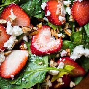 Closeup keto strawberry salad with spinach, basil, pecans and feta
