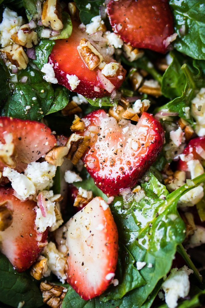 Closeup keto strawberry salad with spinach, basil, pecans and feta