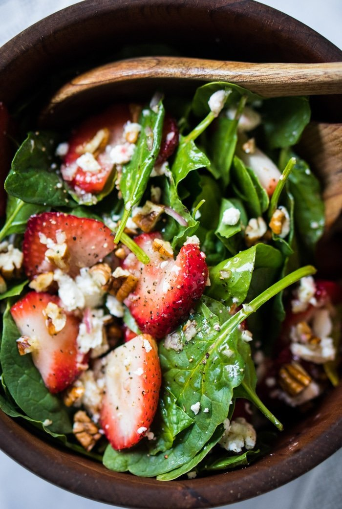Keto strawberry salad in a wooden salad bowl