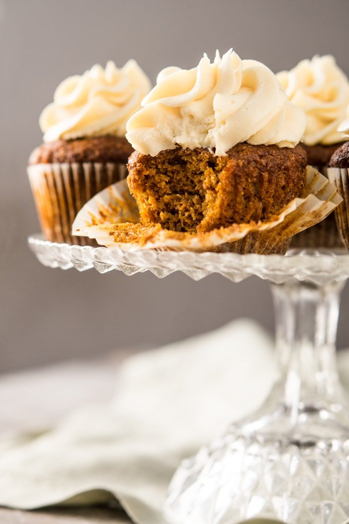 Bitten Gluten Free, Paleo & Low Carb Carrot Cake Cupcakes On A Cake Stand