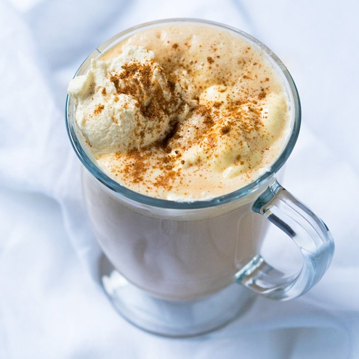 Paleo & keto pumpkin spice latte in a glass mug with whipped cream