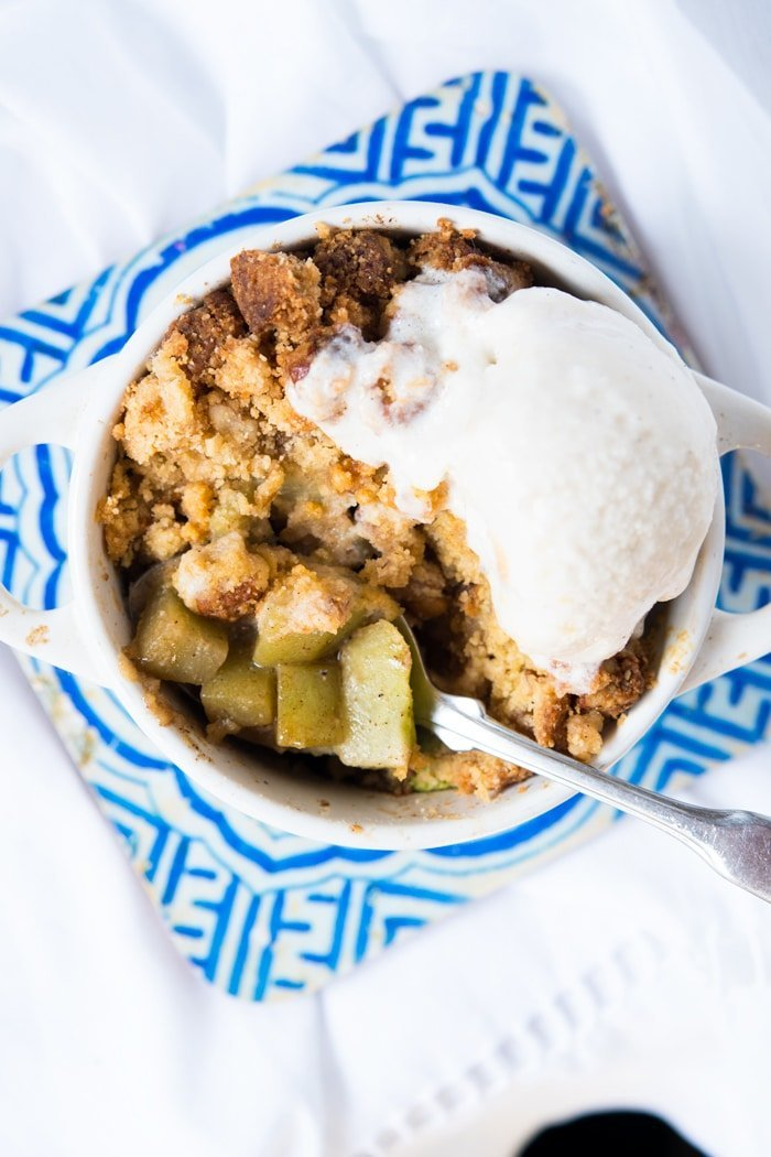Keto apple crumble with a scoop of vanilla ice cream