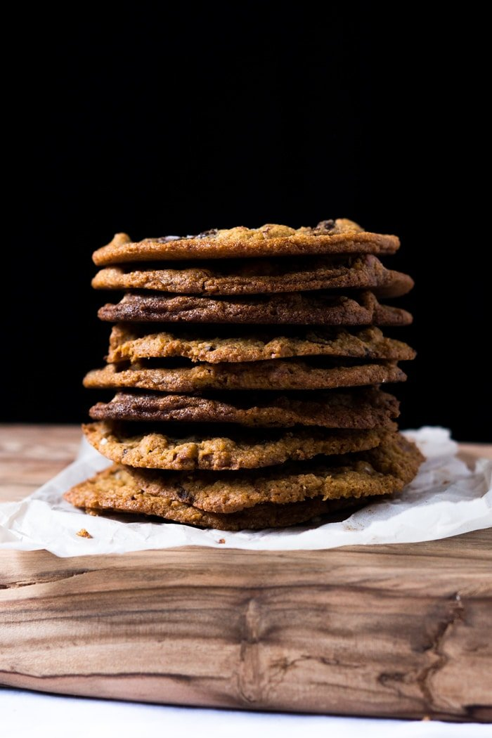 A stack of keto chocolate chip cookies with a black background