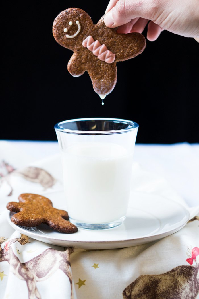 Dunking a keto gingerbread man in milk