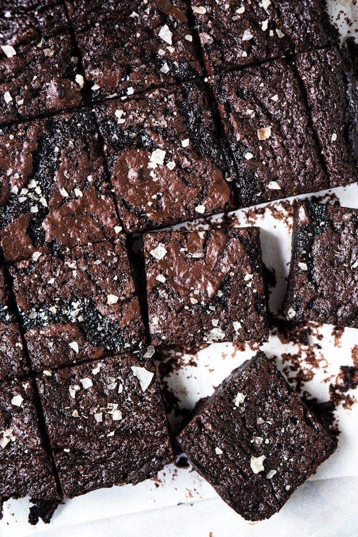 Freshly cut keto brownies with flakey sea salt