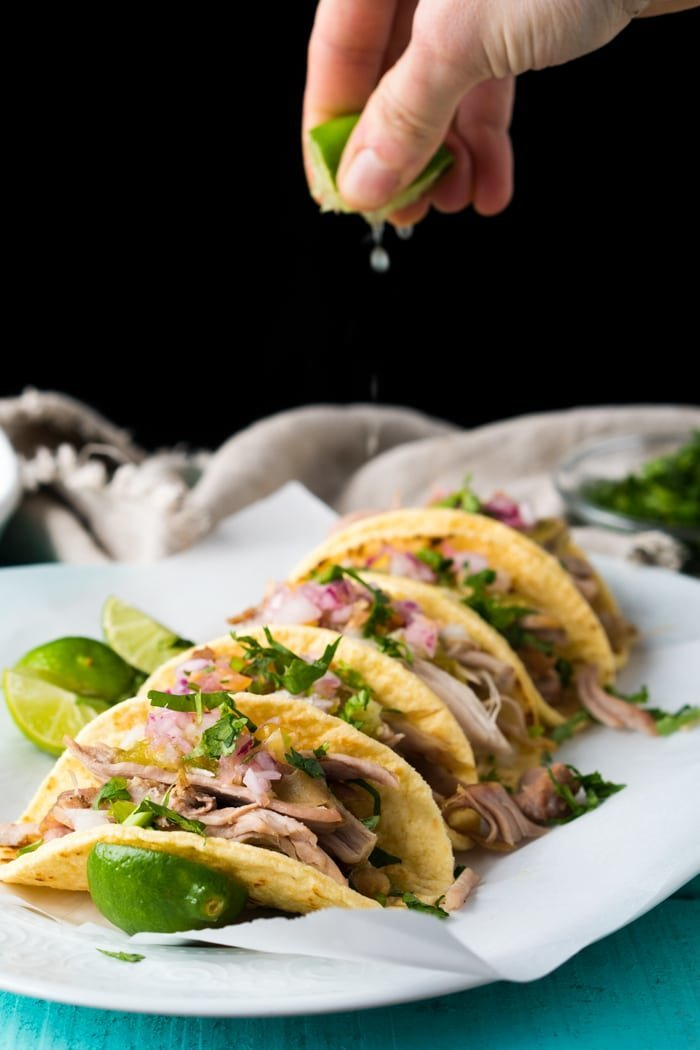 Squeezing a lime unto keto carnitas tacos