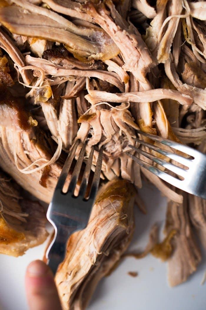 Shredding keto carnitas with two forks