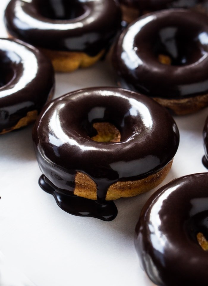 Baked keto donuts with a dripping chocolate glaze