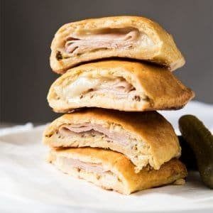 Piled up keto hot pockets with ham and cheese filling