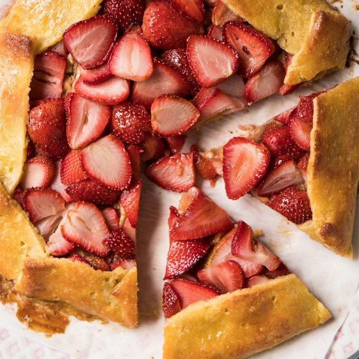 Sliced up keto strawberry galette with pie crust