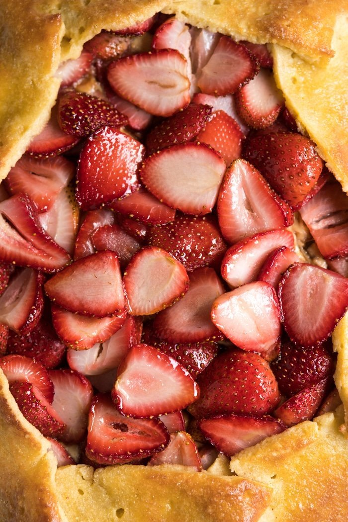 Closeup sliced strawberries in a keto galette