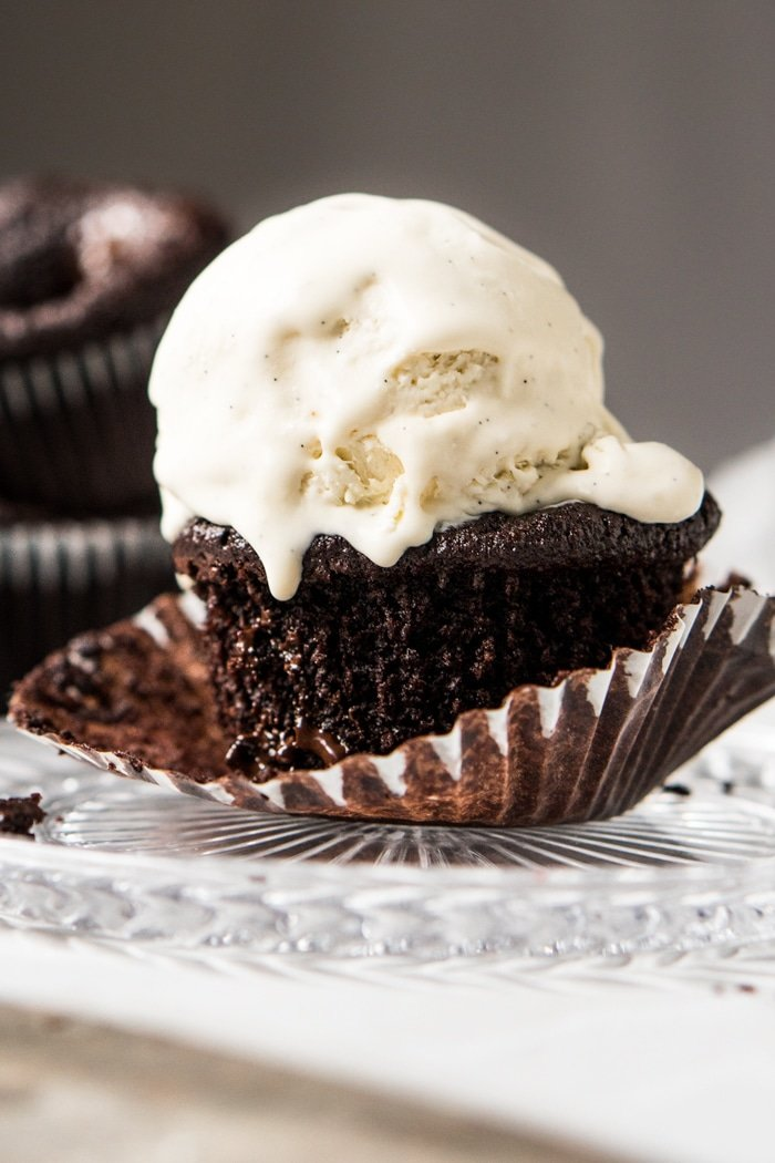 Keto chocolate muffin topped with a scoop of vanilla ice cream