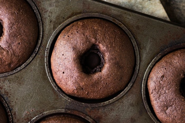 Freshly baked keto chocolate donut in pan