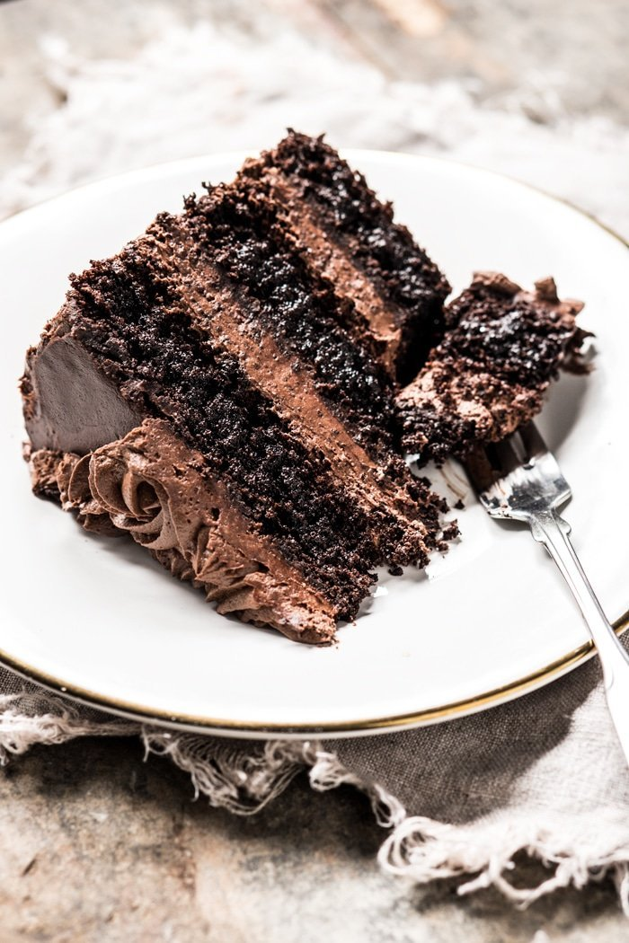 A slice of a layered keto chocolate cake