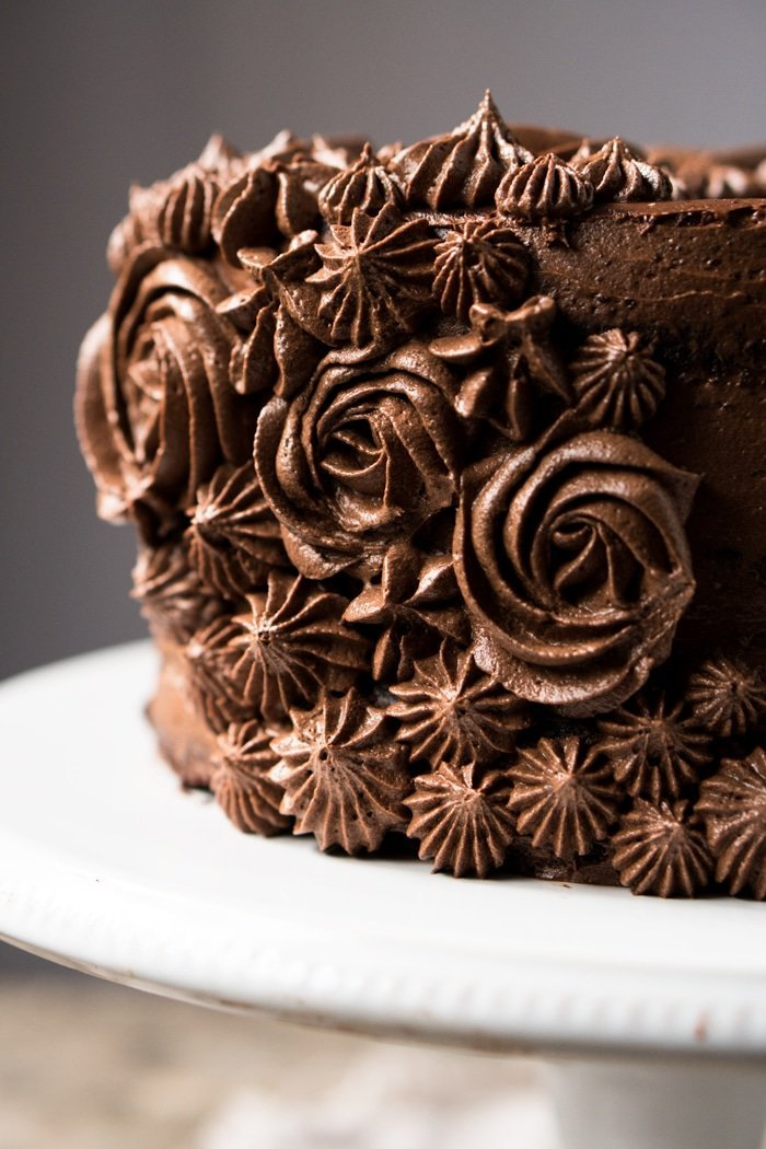 Closeup of chocolate buttercream flowers on a keto chocolate cake