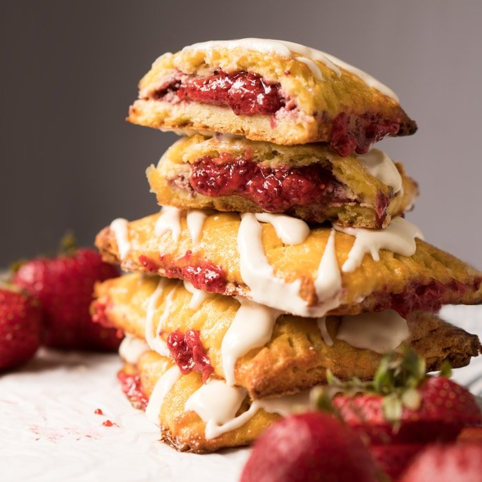 Piled up keto pop tarts with strawberry filling and cheesecake glaze
