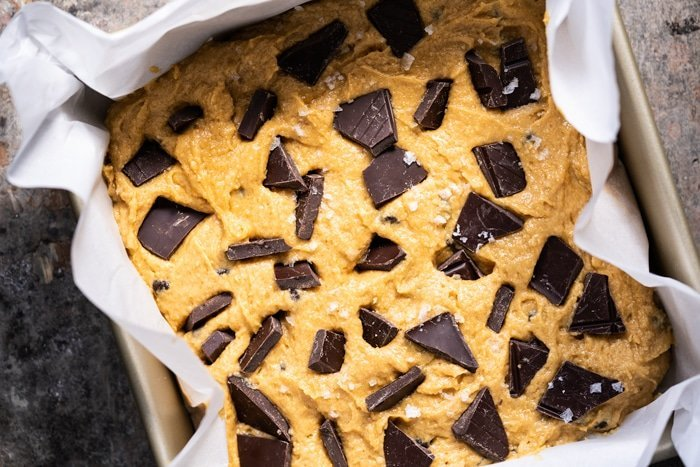 Unbaked keto peanut butter blondies with chocolate chunks