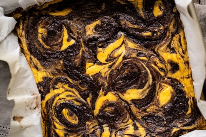 Freshly baked low carb pumpkin cheesecake brownies
