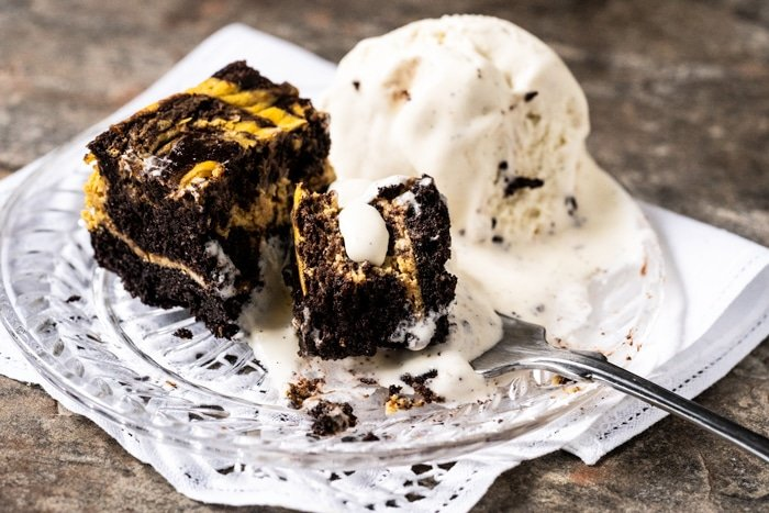 Melting vanilla ice cream with low carb pumpkin cheesecake brownies