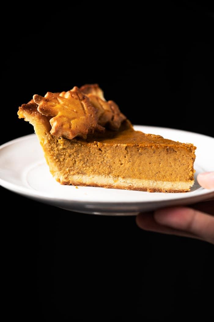 Serving a slice of keto pumpkin pie