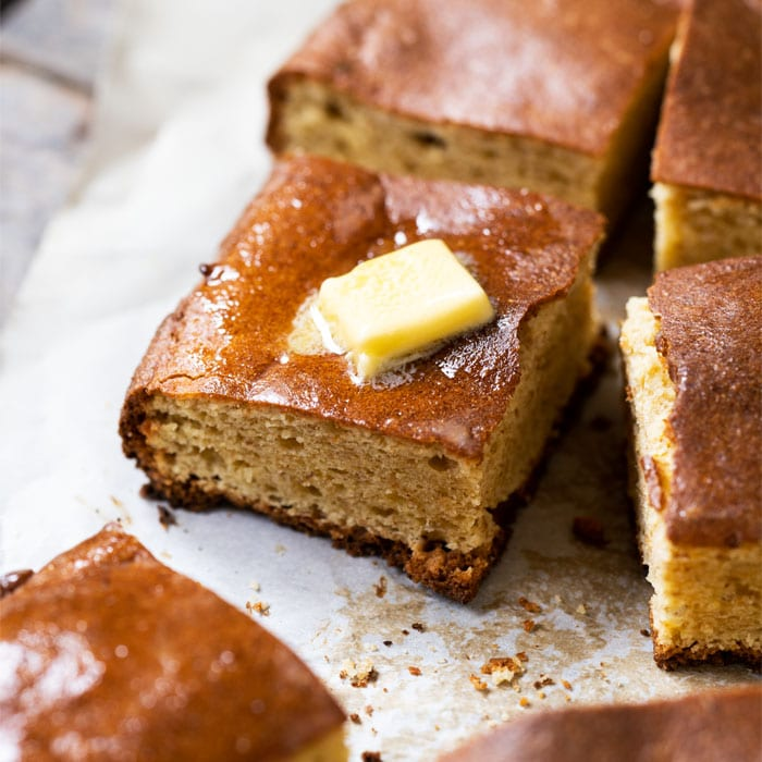 Keto cornbread style quick bread with a pat of butter