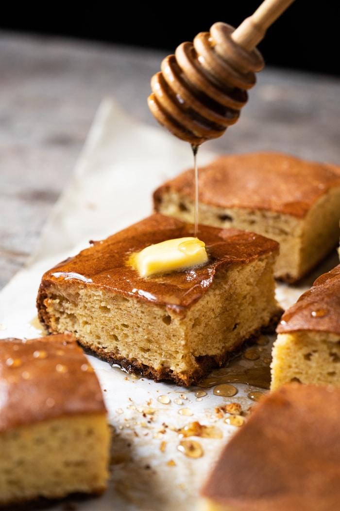 Drizzling 'honey' onto a keto cornbread-style bread