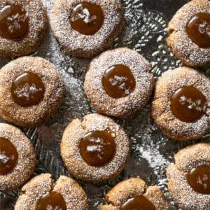 Gluten free & keto salted caramel thumbprint cookies with flakey sea salt