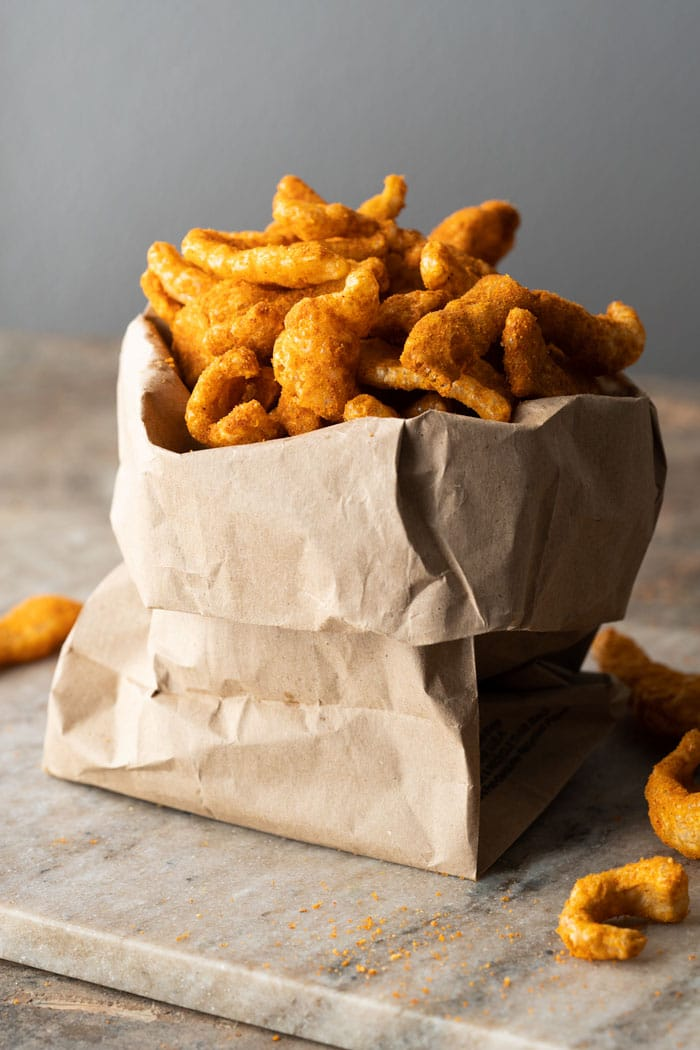 Paleo & keto cheetos in a brown paper bag