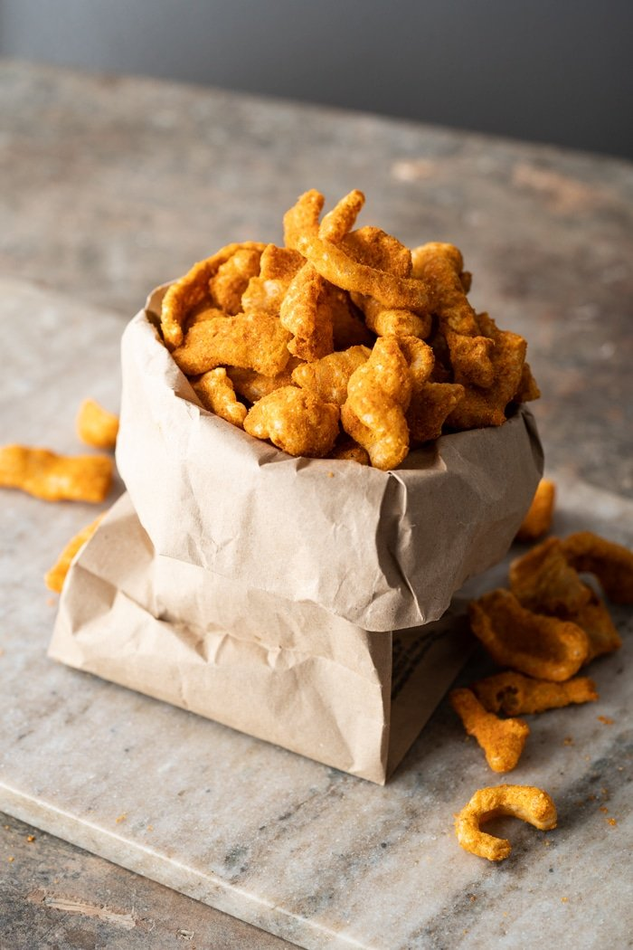 Keto cheetos in a brown paper bag