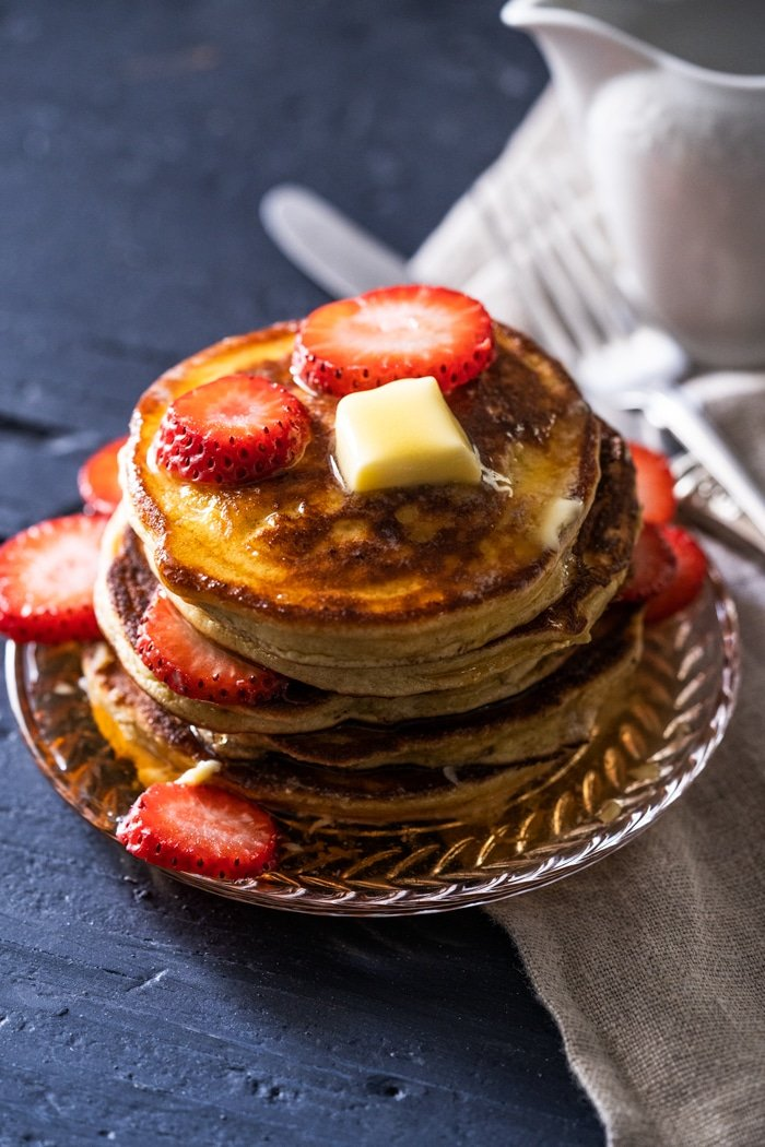A stack of gluten free & keto pancakes with a pat of butter