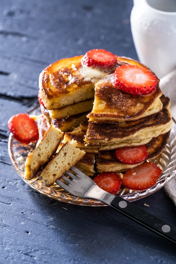 Cut into keto pancakes showing a fluffy texture
