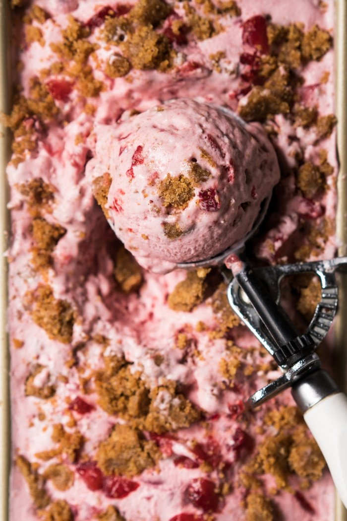 Scooping out gluten free & keto strawberry cheesecake ice cream