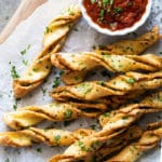 Garlic keto breadsticks with fresh parsley and marinara sauce