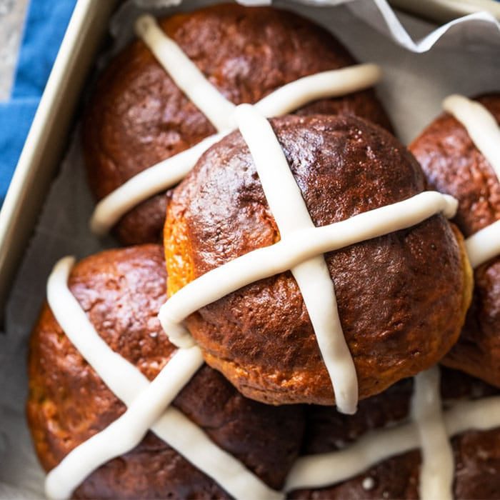 Piled up keto hot cross buns with icing