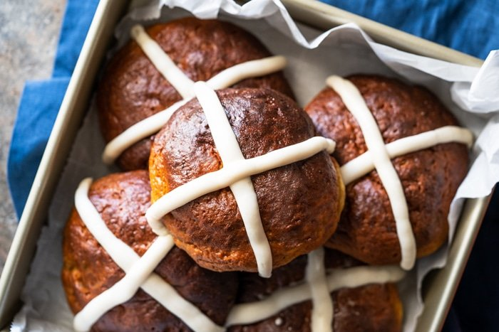 Piled up low carb hot cross buns in a gold baking dish