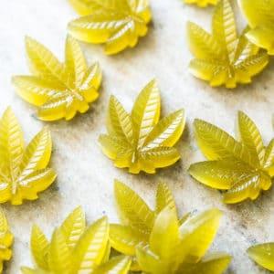 Green keto CBD gummies in cannabis leaf shape