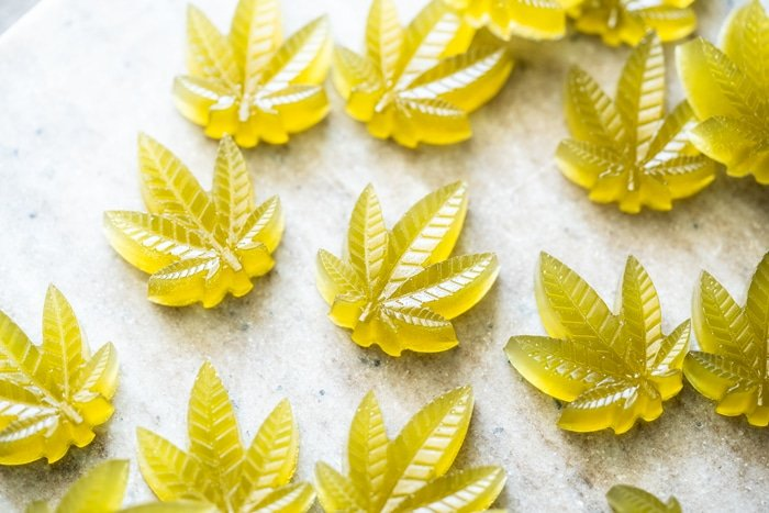 Green keto CBD gummies in cannabis leaf shape