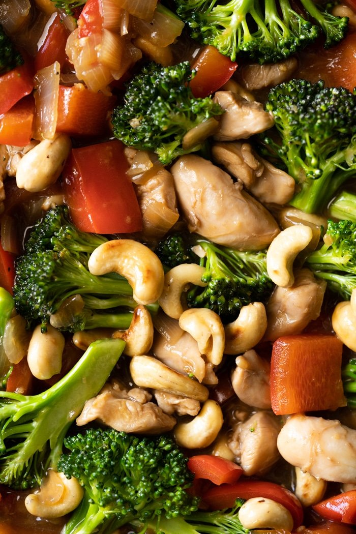 Closeup keto cashew chicken with red peppers and broccoli