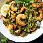 Twirled keto zoodles with pesto, shrimp, lemon & basil