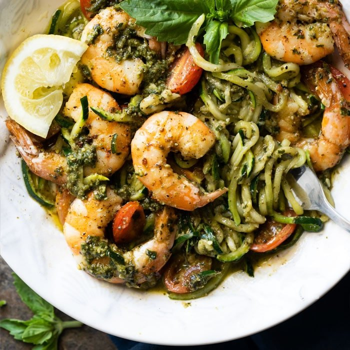 Twirled keto zoodles with pesto, shrimp, lemon & basil