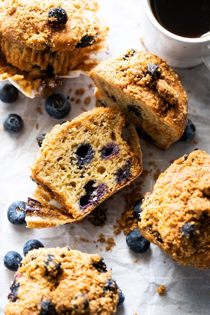 Halved keto blueberry muffin with almond streusel