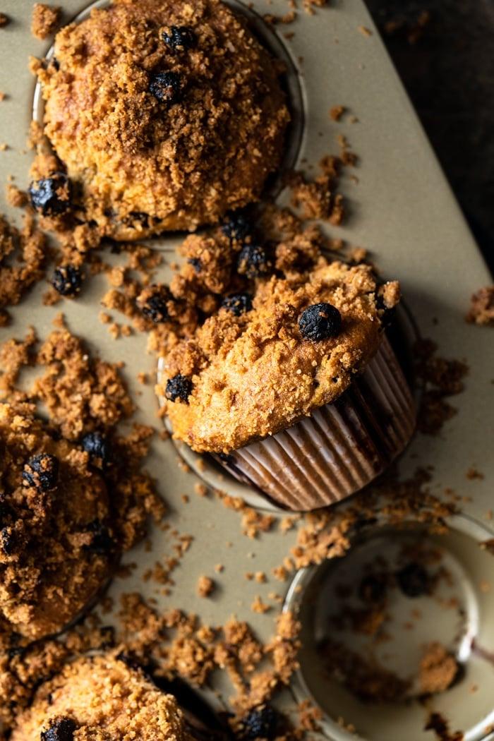 Freshly baked Keto Blueberry muffins in golden tray