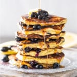 A stack of keto blueberry pancakes with sugar free syrup