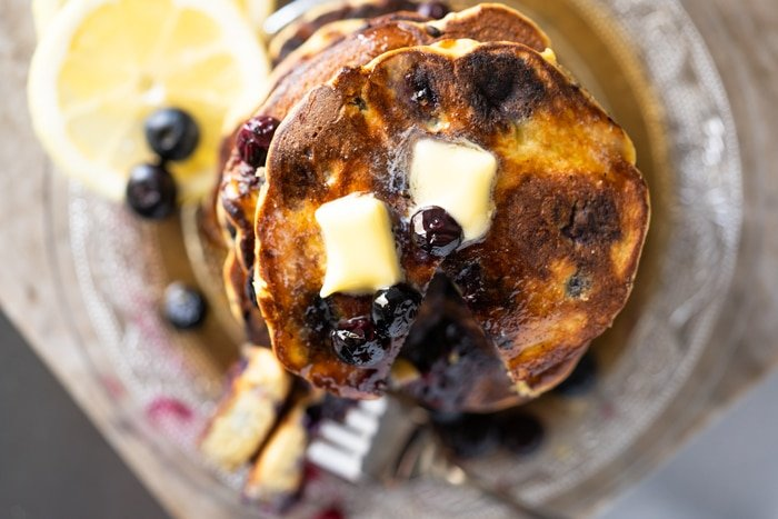Overhead shot of Keto Blueberry pancakes with two pads of butter