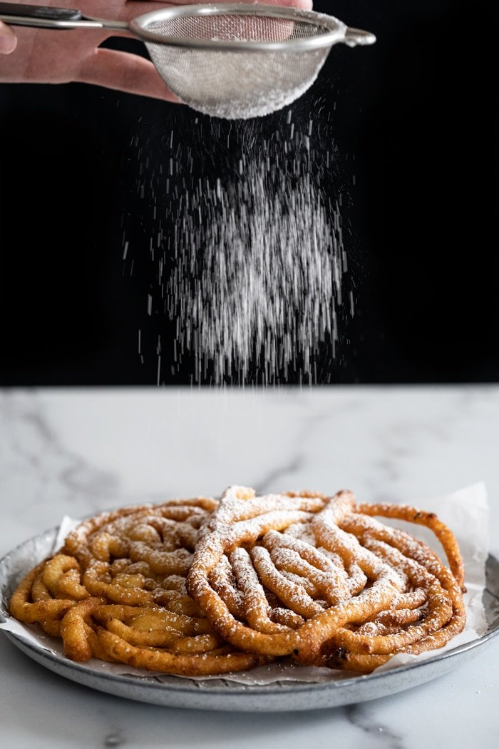 Sprinkling powdered 'sugar' onto keto funnel cakes