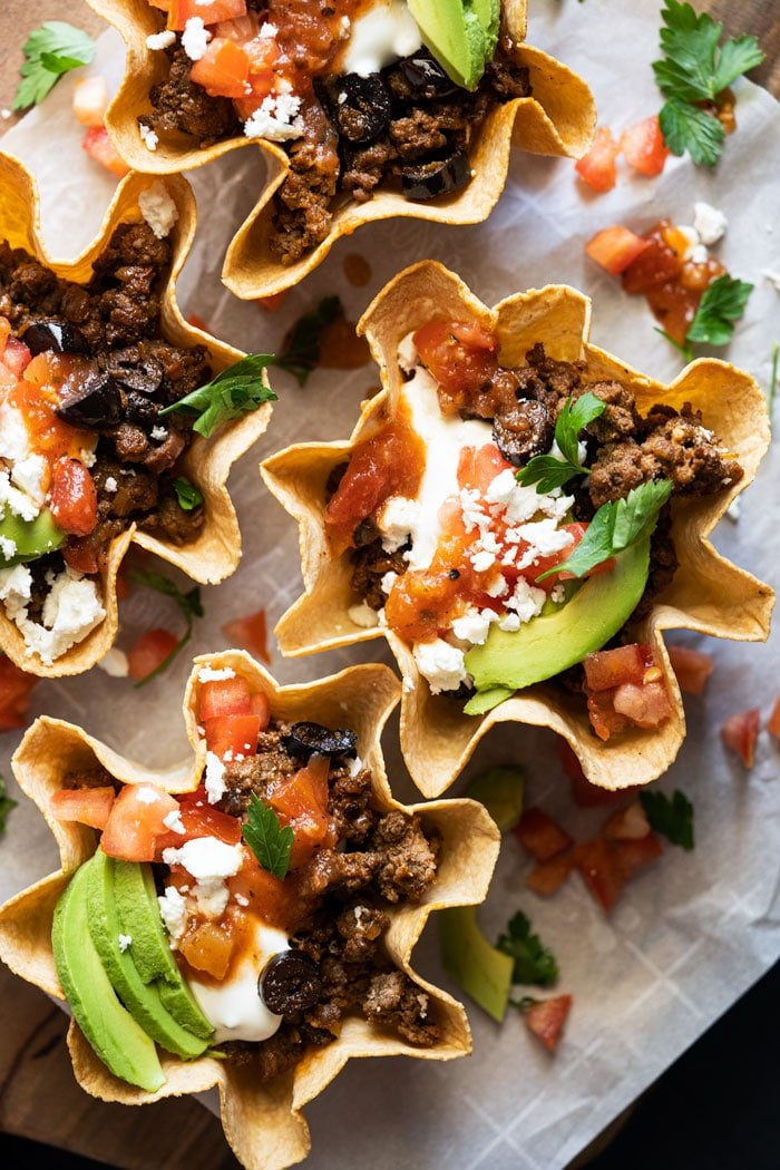 Keto taco bowls with sour cream, salsa and avocado