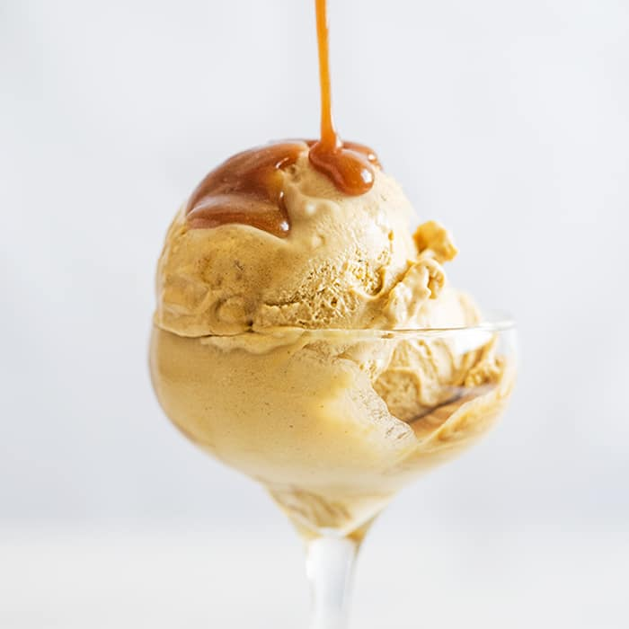 Keto salted caramel ice cream with a sugar free caramel drizzle