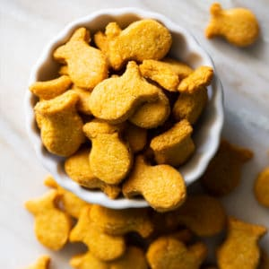 Homemade keto goldfish crackers in a white serving bowl