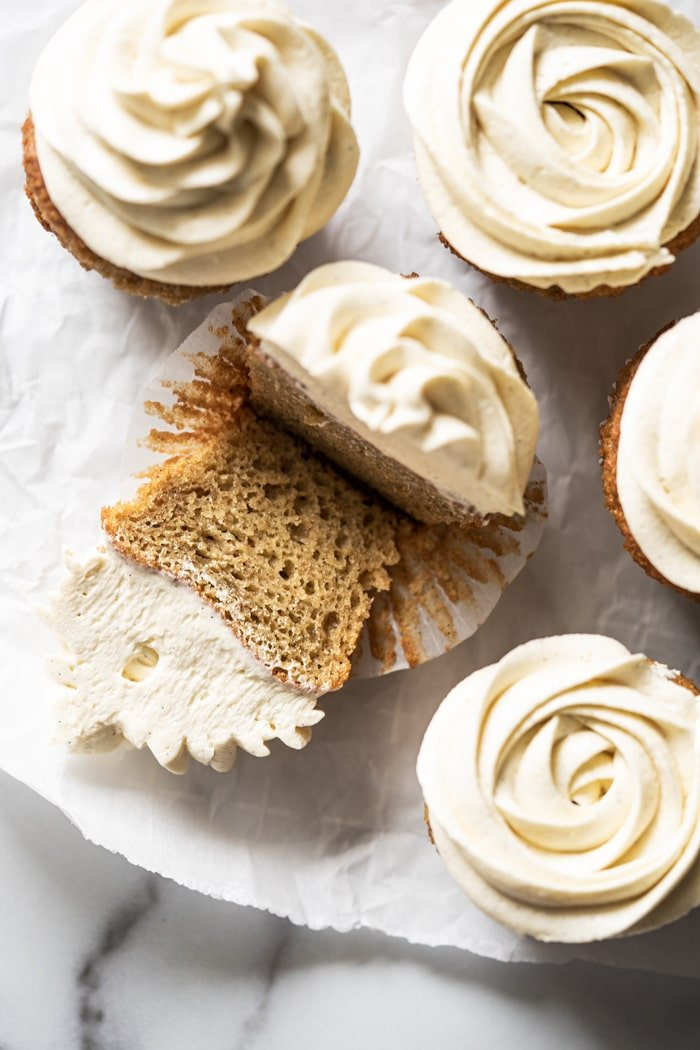 Halved keto vanilla cupcake showing fluffy texture