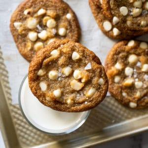 Keto white chocolate macadamia nut cookies with a glass of milk